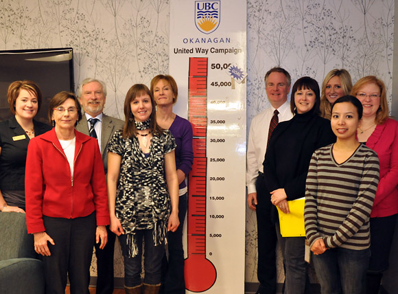Deputy Vice Chancellor and Principal Doug Owram (third from left) congratulated the UBC United Way committee on Friday on the success of this year's campaign. Committee members are (from left): Layne McDougall, Gwen Zilm, Lindsay Peruniak, Deanna Simmons, Don Thompson, Alanna Vernon, Sarah Henderson and Lois Marshall.