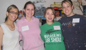 Day of Caring students-turned-construction-experts (from left to right): Kira Robertson, Natasha Hass, Brittany Taylor and Chelsey Forsyth.