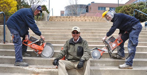 Facilities staff working on the stairway replacement are, from left, Al Prout, Maintenance and Grounds Manager Al King, and James Hembling.