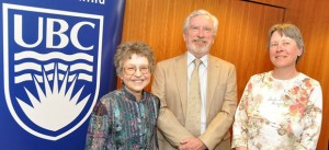 Recognized for 30 years of service on May 9 were Nancy Netting, associate professor of sociology (left), and Maureen Lisle, visual arts technician (right), pictured here with Deputy Vice Chancellor and Principal Doug Owram