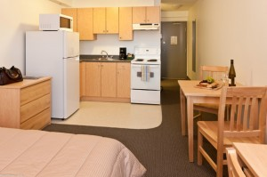 Monashee studio suites feature a queen bed with fully equipped kitchen, private bathroom, desk and air conditioning.