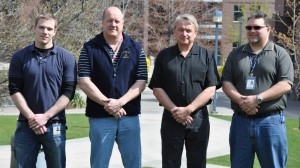 New Security Communications Coordinators (from left to right): Troy Campbell, Marty Schneider, Bill Petrie and Brad Haberstock. Missing from the photo is Matt Leibel.