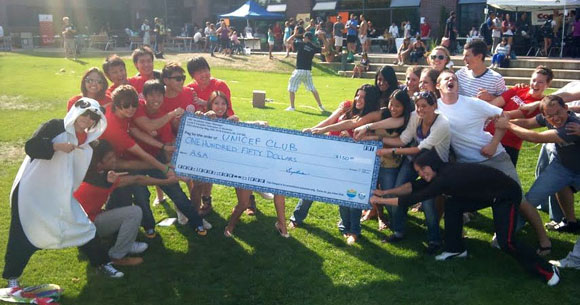 Members of the Asian Student Association (left) have donated $150 to the UNICEF Club on campus. The gift represented half of their $300 prize earned from a valiant second-place effort in the tug-o-war match during Clubs and Course Union Day Sept. 14. The UNICEF Club won the match, earning the top prize of $500.