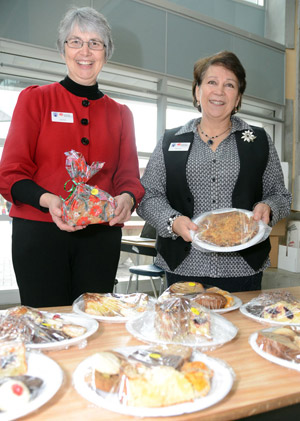 United Way committee members Louise Nelson and Sharon McCoubrey present some of the tasty items that helped make this year's event the most successful yet.