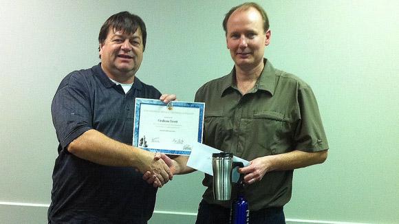 Tournament organizer Greg Bishop (left) congratulates tournament winner Graham Swett