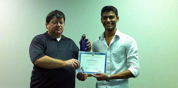 Tournament organizer Greg Bishop (left) congratulates third-place winner Omkrishna Shah