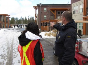 Fire, Life and Safety Technician Brian Toering discusses fire drill evacuation procedures with Residence Life staff.