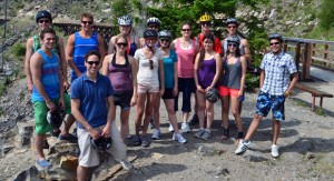 Participants in the mountain biking adventure to Myra Canyon stop for a group photo