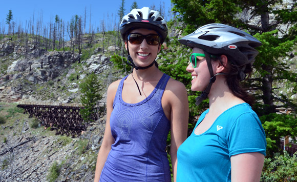 UBC Medical student Lauren Taylor, left, shares some information with prospective medical student Ellie Parton from Campbell River while on the Kettle Valley Rail-beds overlooking Southeast Kelowna.