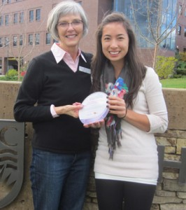 Barb Hoy presents nursing student Robyn Kosugi with the Post-Secondary Challenge Team Captain Leadership Award