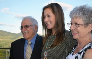 Bachelor of Science in Nursing graduate Treanna Delorme shares a moment with her proud grandparents, Wayne and Judy Wilson from Saskatchewan, on top of the Purcell Residence.
