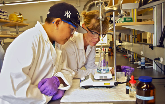 Student Wyatt Dubrett, left, and UBC Lab Technician Michelle Tofteland check out water samples from Kalamalka Lake during the engineering and environmental studies workshop.