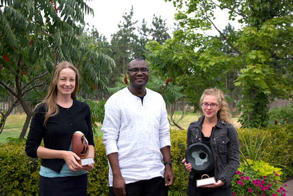 Dean Wisdom Tettey (centre) presents the new FCCS awards for Teaching Excellence and Teaching Innovation to winners Karis Shearer (left) and Allison Hargreaves (right).