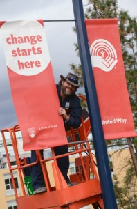 Chris Kraft from Facilities Management installs new United Way banners for the 2013 campaign