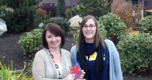 Jessica Beck (right), is presented with her Carpool Month prize by Dina Curtis from Parking Services.