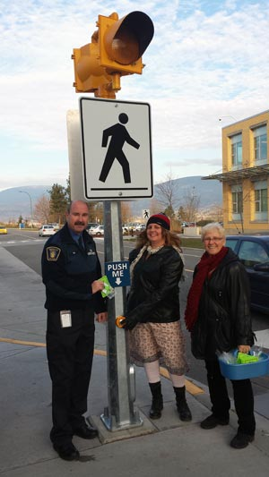 Security Coordinator Mike Gesi and graduate student Lynn Eileen show off pedestrian safety reflectors with ICBC Road Safety Coordinator Christine Silver.
