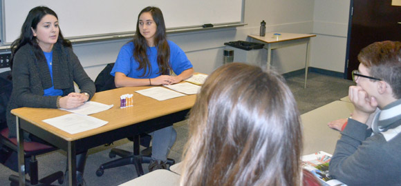 : Aboriginal Programs & Services (APS) student staff Lisa Renaud, left, and Ashleigh Green engage a group of Grade 9 and 10 students from various school districts.