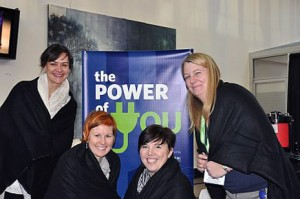 From left:  UBC staff members Jennifer Novy, Shauna Oddleifson, Melissa McHugh and Cara Kirkey bundle up with FortisBC blankets distributed at the Power of You Bundle Up event.