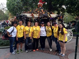 Shiela Epp, third from left, is surrounded by volunteers from the California's Orange County sheriff's department (in the white t-shirts), Dreamlift buddies and two of the Operation Dreamlift children, Charlotte (to Epp's left) and Hayley, far right.