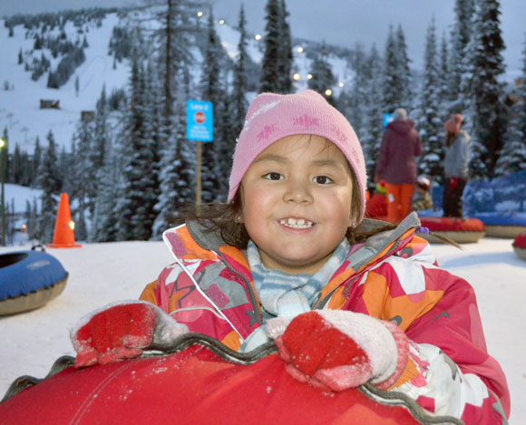 Feather Mason, daughter to UBC student Stephanie Mason, gets set to travel down the groomed tracks at Tube Town.