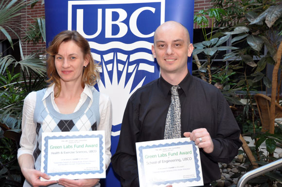 Zoё Soon (left) and Tim Abbott accept certificates for their Green Research Fund proposals.