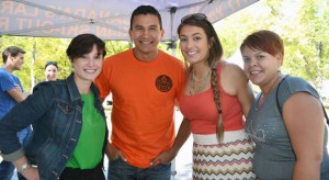 UBC students Kelly Panchyshyn, left to right, Elora Bascello and Mary Song jumped at the chance to be photographed with the charismatic Wab Kinew at the Okanagan Nation Alliance Salmon Feast in Okanagan Falls.