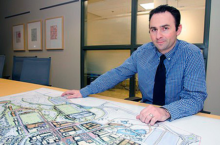 Anthony Haddad, Director, Okanagan Campus Planning and Development, with a concept drawing from the draft UBC Okanagan Master Plan.