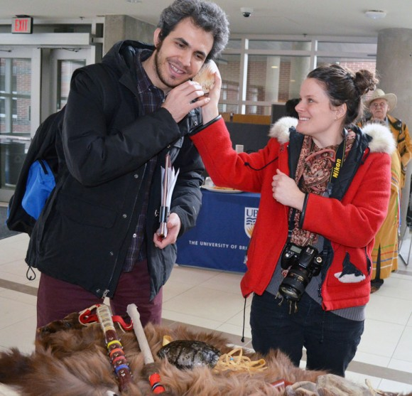 Equity and Inclusion Office Educator Jenica Frisque enjoys the many Métis artifacts with student Amin Mansouri.