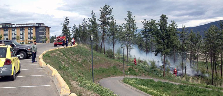 The Kelowna Fire Department was on hand to deal with a small grassfire above H lot on April 30. (Photo credit: Dan Odenbach)