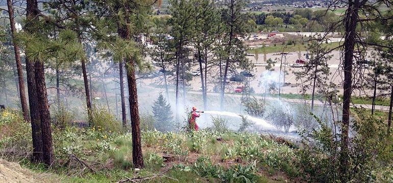 Another photo of the Kelowna Fire Department dealing with a small grassfire above H lot on April 30. (Photo credit: Dan Odenbach)
