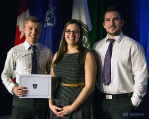 UBC civil engineering students Blake Cloutier (left) and Andre Prohoroff are presented with their second-place award by Amie Therrien, the Student and Young Professionals Program Coordinator, at the Canadian Society for Civil Engineering annual conference earlier this summer.