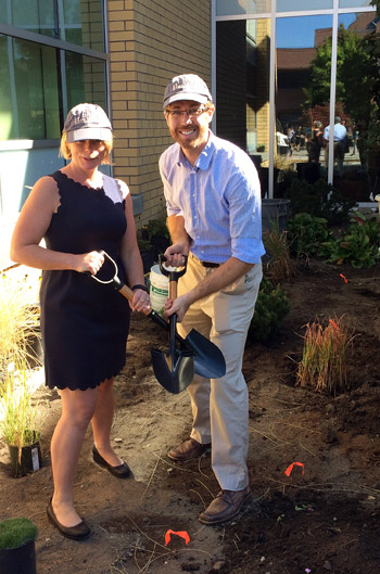 Shelley Kayfish, director of Campus Operations and Risk Management, and Derek Mahoney, manager of maintenance and grounds, break ground on the new xeriscape garden in front of the Engineering Management Education building. Photo credit: Kristin Forcier