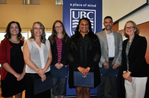 2016 Staff Awards of Excellence winners Alana Jordan, Cherie Michels, George Athans and Leah Sanford stand with (far left) Director of Student Development and Advising Michelle Lowton and (far right) Deputy Vice-Chancellor and Principal Deborah Buszard.