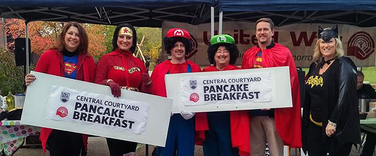 "Celebrating our roles as ""everyday heroes"" when we support the United Way, a team of superheroes from the United Way of the Central and South Okanagan/Similkameen visited campus to help out with the campaign-launching Pancake Breakfast on October 11."