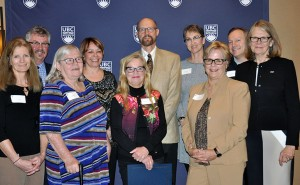 Deborah Buszard deputy vice-chancellor and principal of UBC Okanagan (right) and Lisa Castle vice-president UBC Human Resources (third from right) congratulate (from left) Carol Boyd, Greg Wetterstrand, Linda Allan, Kim Filice, Mary Ann Murphy, Robert Belton, Nina Langton and Donovan Hare.