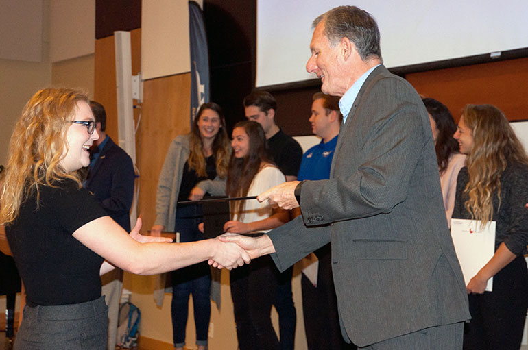 Human kinetics student Lindsey Berthelsen is congratulated by Associate Vice-President, Students Ian Cull at a special breakfast event last week.