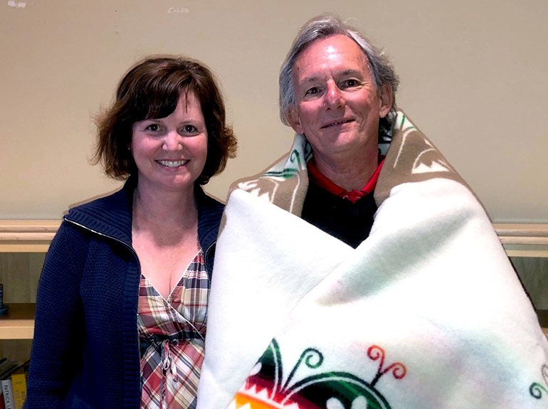 On behalf of UBC Okanagan, at the Aboriginal Advisory Council meeting on June 8,  Laura Cull presented husband Ian Cull with a commemorative Creation Turtle blanket.