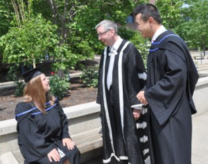 UBC President Stephen Toope chats with new Bachelor of Arts degree recipients Julie Ferris, left, and James Liao, right, following Friday morning's Convocation ceremony at UBC Okanagan.