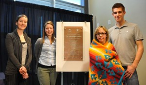With the new plaque dedicating the Aboriginal Centre are, from left, students Tamina de Montezuma, Irene Gonneau, Tanya Gregoire, and Nick Therrien.