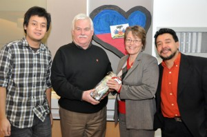 From left, UBC Okanagan student Adi Prabowo, who helped organize last Sunday's Haiti benefit concert at UBC Okanagan, John Richey, regional manager of the Southern Interior Canadian Red Cross, Teresa Flanagan, international student advisor, and Professor Hugo De Burgos, one of the musicians who performed at the event.