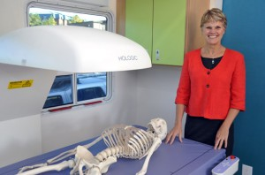 Heather McKay, Director of the Centre for Hip Health and Mobility, with one of the medical imaging systems housed in the new mobile lab that will be used for bone and hip health research throughout B.C.