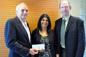 Dr. Allan Jones, Associate Regional Dean, Southern Medical Program, accepts a cheque for $30,000 from Dr. Sue Randhawa and Dr. Brian Brodie, President, B.C. Medical Association, to create the Southern Medical Program's first scholarship endowment.