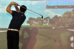 It's freezing outside but Stefan Bigsby, a member of the UBC Okanagan Heat varsity golf team, can keep training indoors using a golf simulator at iQuest in Kelowna.