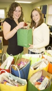 Vanessa Lavalley, left, a second-year  Bachelor of Management student from  Calgary who lives on-campus at UBC  Okanagan, receives her final exam  care package from Residence Coordinator  Kim Colangelo.