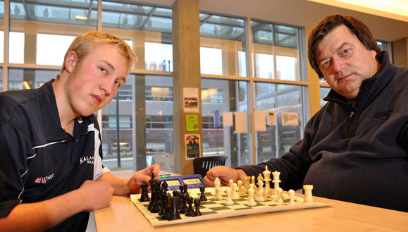 Sean Kelman, left, won a recent fund-raising chess tournament in Vernon, defeating Greg Bishop in a blitz playoff game. The UBC Okanagan Chess Club is hosting a tournament at UBC Okanagan January 23.
