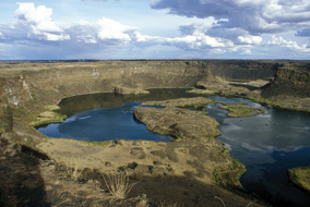 The Dry Falls in Washington's Scablands is a basalt scarp 120 metres high and 10 times wider than Niagara Falls - photo by Robert Young