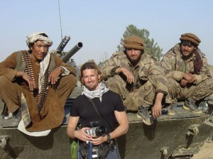 War correspondent Kevin Sites, seen here with Afghan fighters, will speak in Kelowna on January 14.