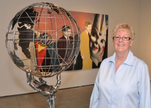 Curator Susan Belton  views an untitled 2007 steel  sculpture symbolizing global citizenship by Vernon artist Cory Fuhr, part of the Male Perspective art exhibit at UBC's Fina gallery.