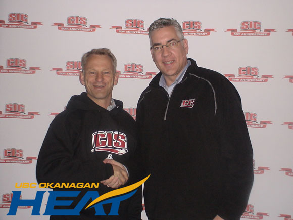 CIS president Leo MacPherson congratulates Rob Johnson, director of athletics at UBC's Okanagan Campus