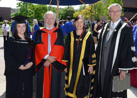 UBC graduate Shawna Hodgkinson, left, Deputy Vice-Chancellor and Principal Doug Owram, Chancellor Sarah Morgan-Silvester and President Stephen Toope pose for a picture after the convocation ceremony Thursday. A record number of students graduated this year.